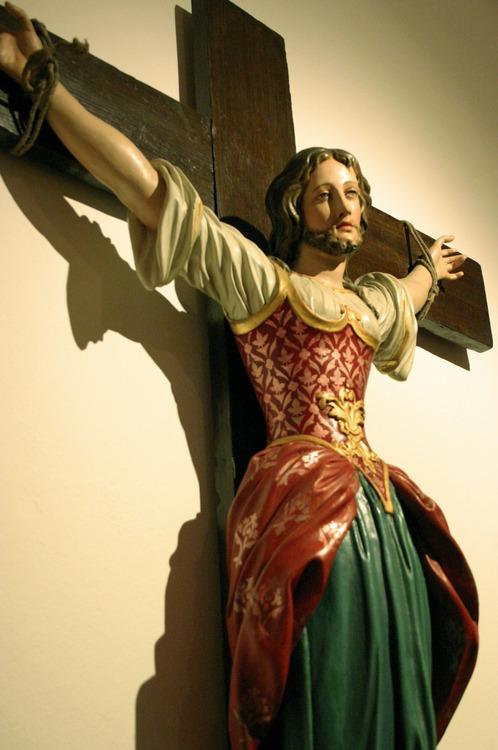 Bearded female saint on the cross