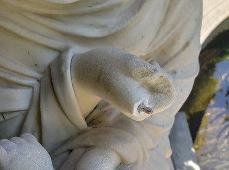 Marble hand exhibiting material loss