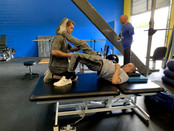 Chad Bui (Stroke) works with our specialist Nathan Smeester.