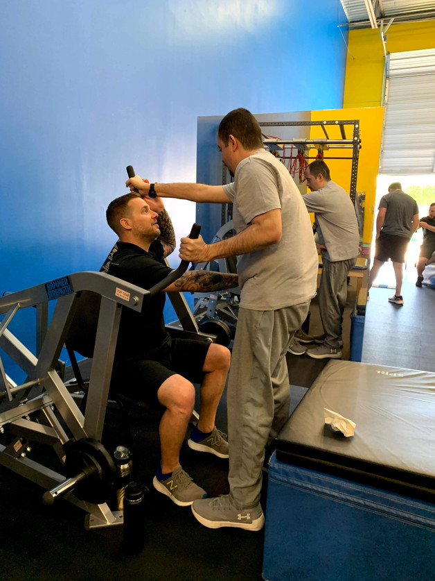 Oscar Frasser (Stroke) works with our specialist Ross LaBove on the Arm & Hammer.