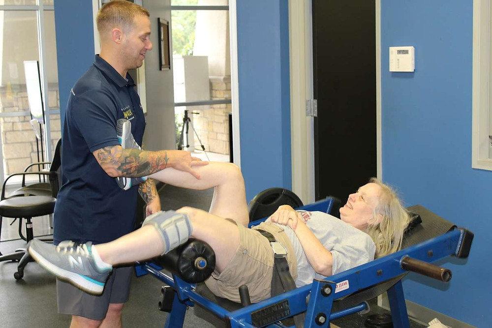 Susan Goble works on her single leg hip extension on the hip/glute machine