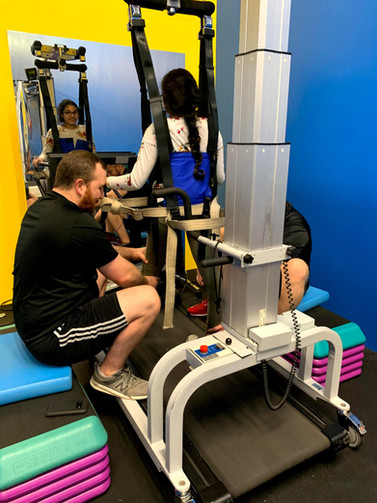 Mehakdeep Minhas (SCI) is working on the LiteGait and treadmill with our specialist Jacob Calhoun.