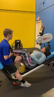 Courtney Meredith is using the Total Gym with our specialist Nathan Smeester.