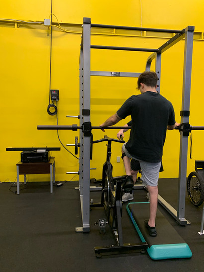 Saleem Baltaji (SCI) is using the spin bike to work on his coordination with our specialist Nathan Smeester.