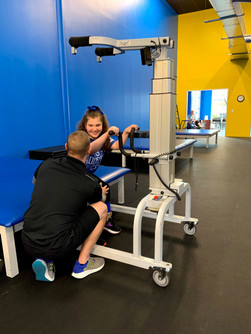 Aubree Ford (CP) is getting ready to use the LiteGait with our specialist Ross LaBove.