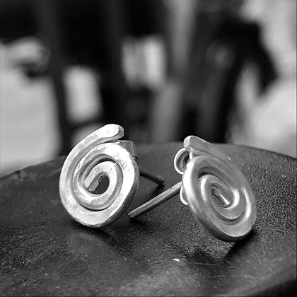 Tiny silver spiral stud earrings