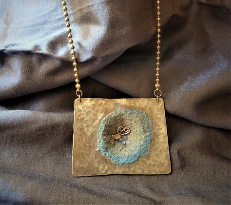 Ancient style hammered pendant on balls brass chain