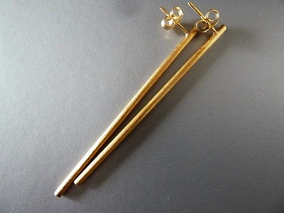 Long rod stud earrings.