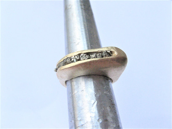 Elongated gold ring with hidden natural Pyrite gemstone.
