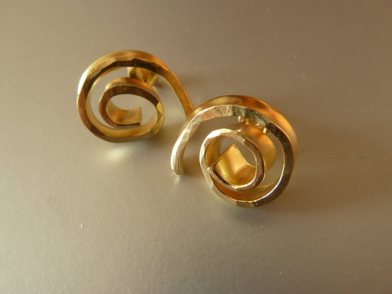 Spiral stud earrings. Golden unique studs.