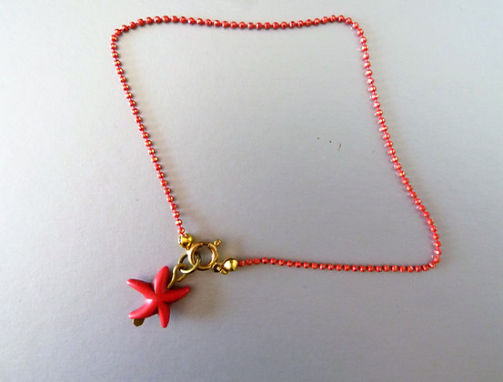 Red foot bracelet with starfish