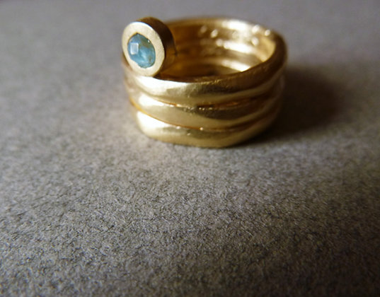 Wide gold ring with Turquoise gem