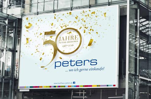Kunde: Kaufhaus-Peters, Achern  Projekt: 50Jahre Jubiläumsaktion, Keyvisual, Umsetzung:, anzeigen, Wandbanner, Postkarten, Kundenstopper Schaufensterbeschriftung