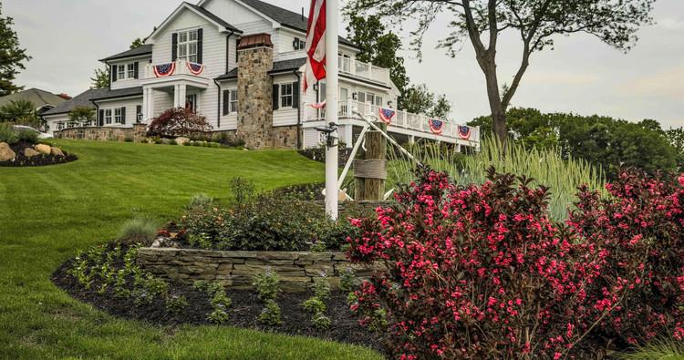 Fieldstone veneer and lush landscaping