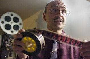 Gerhard holding film.jpg