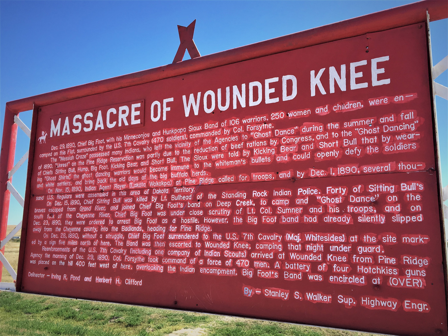 8-massacre of wounded knee sign icloud 1