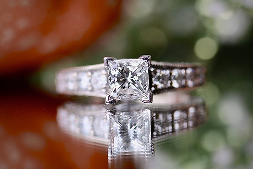 PRINCESS CUT ENGAGEMENT RING WITH ROUND ACCENTS