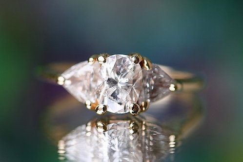 CUSHION AND TRILLION CUT THREE STONE ENGAGEMENT RING