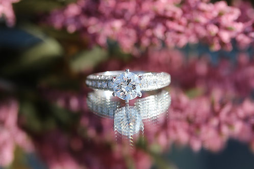 ROUND BRILLIANT CUT DIAMOND ENGAGEMENT RING WITH BEAD SET ACCENTS