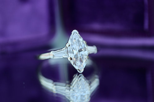 MARQUISE CUT DIAMOND ENGAGEMENT RING WITH BAGUETTE ACCENTS