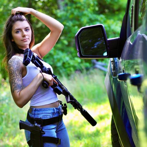 Girl with Gun.JPG