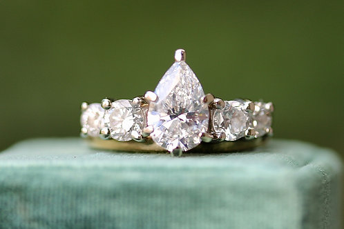 PEAR CUT ENGAGEMENT RINGS WITH ROUND DIAMOND WRAP