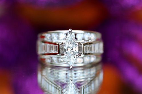 MARQUISE, ROUND & BAGUETTE DIAMOND ENGAGEMENT RING