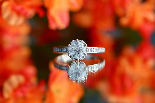 ROUND DIAMOND ENGAGEMENT RING WITH HALO AND ACCENT DIAMONDS