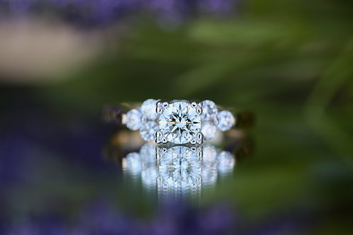 ROUND DIAMOND ENGAGEMENT RING WITH TRINITY ACCENT