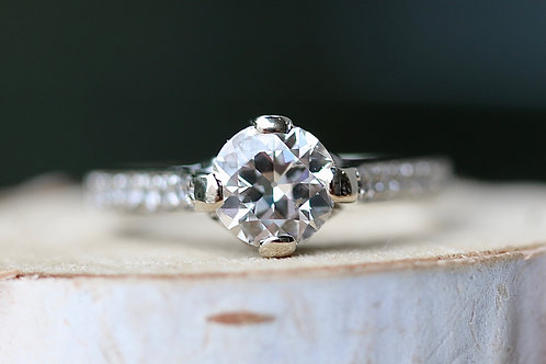 ROUND DIAMOND SCROLL DETAILED ENGAGEMENT RING