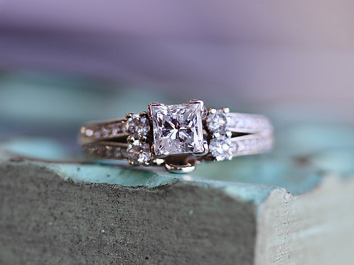 PRINCESS CUT SOLITAIRE WITH ROUND DIAMOND ENHANCER