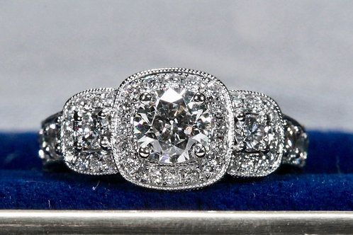 PAST, PRESENT & FUTURE DIAMOND ENGAGEMENT RING WITH HALO