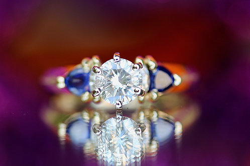 ROUND DIAMOND AND SAPPHIRE ENGAGEMENT RING