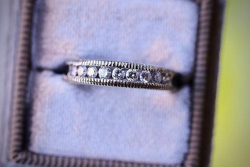 ROUND DIAMOND MILLEGRAIN WEDDING BAND