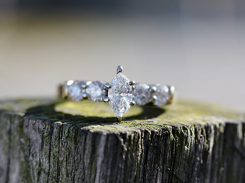 MARQUISE ENGAGEMENT RING WITH ROUND DIAMOND