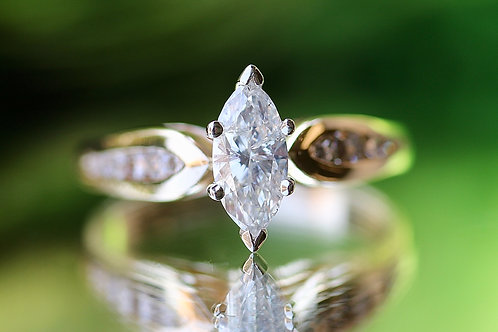 MARQUISE CUT DIAMOND ENGAGEMENT RING WITH ACCENTS