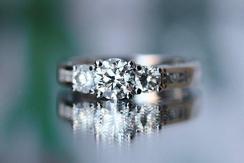 ROUND DIAMOND THREE STONE ENGAGEMENT RING