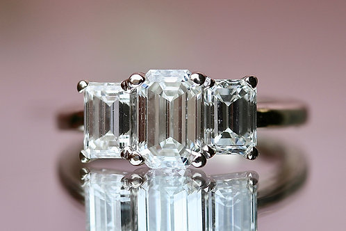 EMERALD CUT PAST, PRESENT AND FUTURE ENGAGEMENT RING