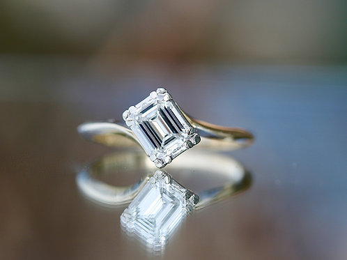 DIAGONALLY SET EMERALD CUT SOLITAIRE ENGAGEMENT RING