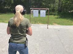 Girl shooting on range, Chesapeake Gun Shop Girl, Chesapeake Virginia Gun Store