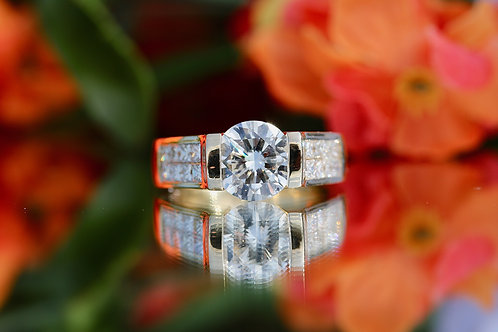 TENSION-SET ROUND DIAMOND ENGAGEMENT RING