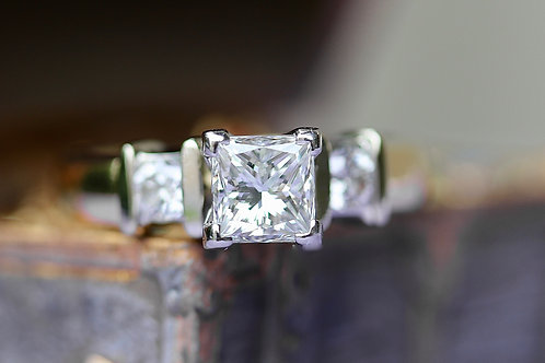 PRINCESS CUT AND ROUND DIAMOND THREE STONE ENGAGEMENT RING