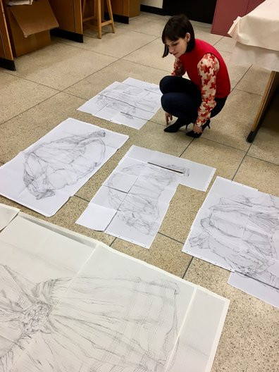 Casey_with_drawings_made_on_site_at_RF