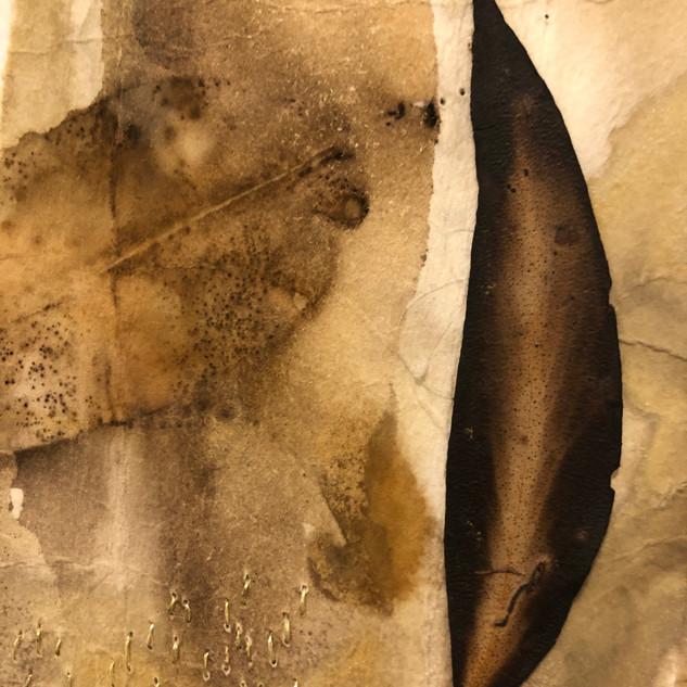 Gabrielle Mordy. 4th January 2020, Morton National Park 2. Plant dyed hahnemühle paper, burnt leaf & metallic thread. 9.5 x 13cm.