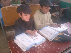 Displaced children studying in TLC