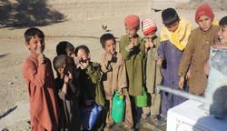 Children at newly installed handpump