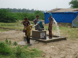 Children using new handpump to bath