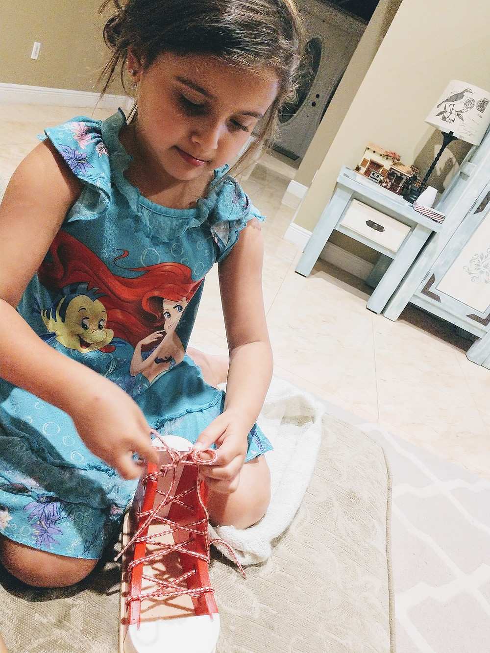 Jenn's-daughter-learning-to-tie-shoes