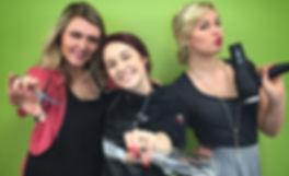 Hairdressing students posing like charlie's angels enjoying school