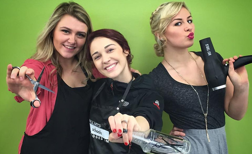 Hairdressing students posing like charlie's angels enjoying school